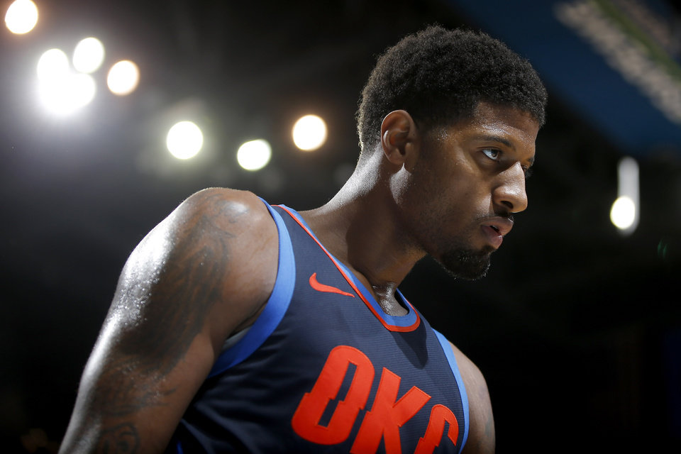 Photo - Oklahoma City's Paul George (13) walks off the court late in an NBA basketball game between the Oklahoma City Thunder and the Sacramento Kings at Chesapeake Energy Arena in Oklahoma City, Sunday, Oct. 21, 2018. Photo by Bryan Terry, The Oklahoman