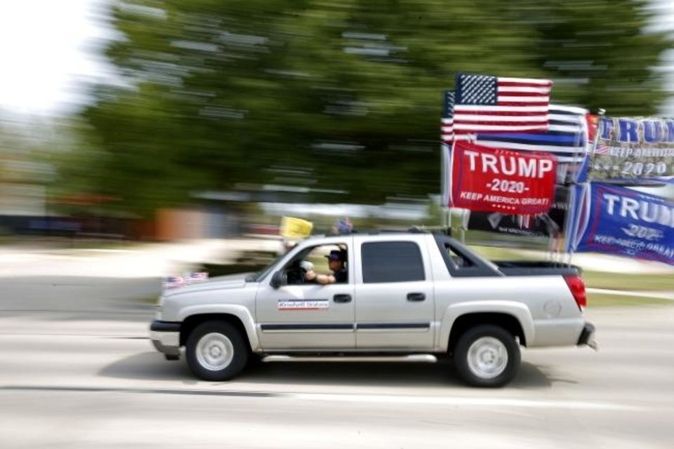 Photo -  A truck decorated to show support for President Donald Trump travels south on Lincoln Boulevard Saturday. [Bryan Terry/The Oklahoman]