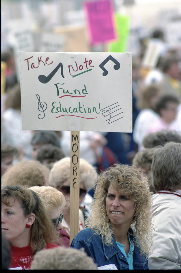 Photo - On April 16, 1990, protesters carrying signs for education reform gathered at the state Capitol. [Photo by Jim Beckel, The Oklahoman Archives]