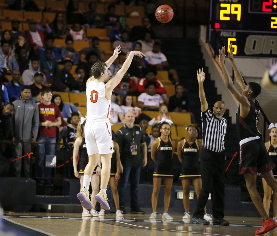 Photo - Tulsa Washington's Trey Phipps  shoots  3-pointer during the Class 6A boys championship game between Putnam City North and Tulsa Washington in the state basketball tournament at the Mabee Center in Tulsa, Okla., Saturday, March 9, 2019. Photo by Bryan Terry, The Oklahoman