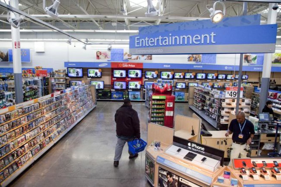 Photo -  A view of the entertainment section of a Walmart store is seen in Alexandria, Va.  [AP PHOTO]