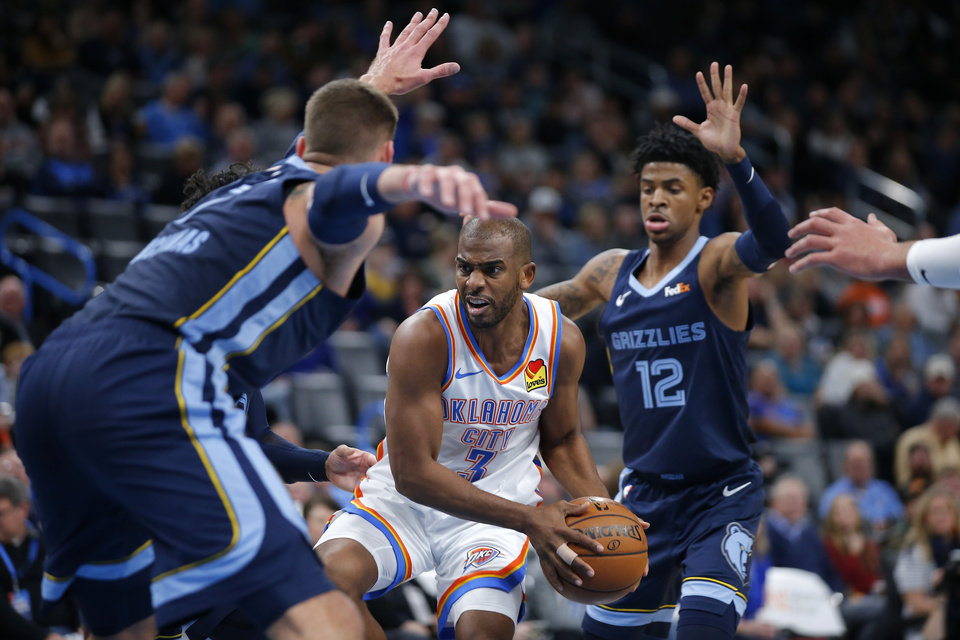 Photo - Oklahoma City's Chris Paul (3) goes past Memphis' Ja Morant (12) during an NBA basketball game between the Oklahoma City Thunder and the Memphis Grizzlies at Chesapeake Energy Arena in Oklahoma City, Wednesday, Dec. 18, 2019. Oklahoma City won 126-122. [Bryan Terry/The Oklahoman]
