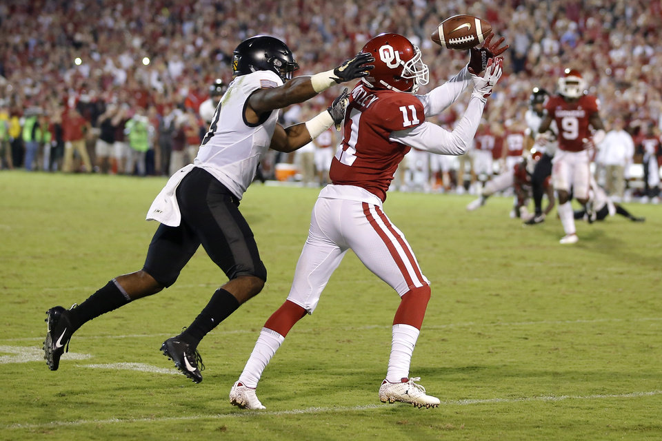 Photo - Oklahoma's Parnell Motley (11) intercepts a pass in front of Army's Jordan Asberry (3) to win the game for Oklahoma during a college football game between the University of Oklahoma Sooners (OU) and the Army Black Knights at Gaylord Family-Oklahoma Memorial Stadium in Norman, Okla., Saturday, Sept. 22, 2018. Oklahoma won in overtime 28-21. Photo by Bryan Terry, The Oklahoman