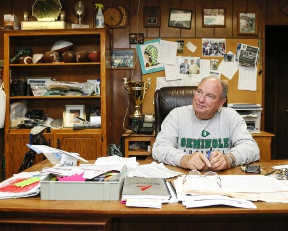 Photo -  Seminole High School football coach Mike Snyder — who won his 364th game last Friday, the most in Oklahoma history — sits in his office at Chieftain Stadium on Wednesday. [Nate Billings/The Oklahoman]