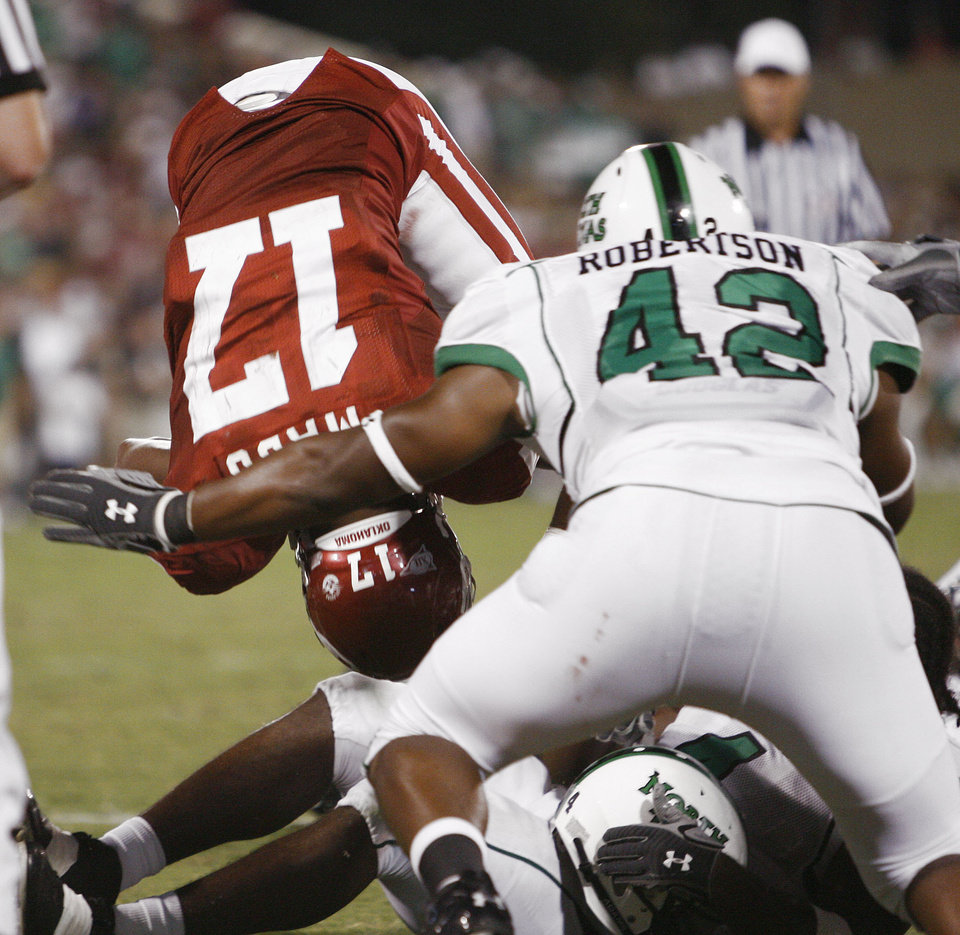 Photo - Oklahoma running back Mossis Madu (17) dives/flips into the endzone for a touchdown in the second half during the University of Oklahoma Sooners (OU) college football game against the University of North Texas Mean Green (UNT) at the Gaylord Family - Oklahoma Memorial Stadium, on Saturday, Sept. 1, 2007, in Norman, Okla.