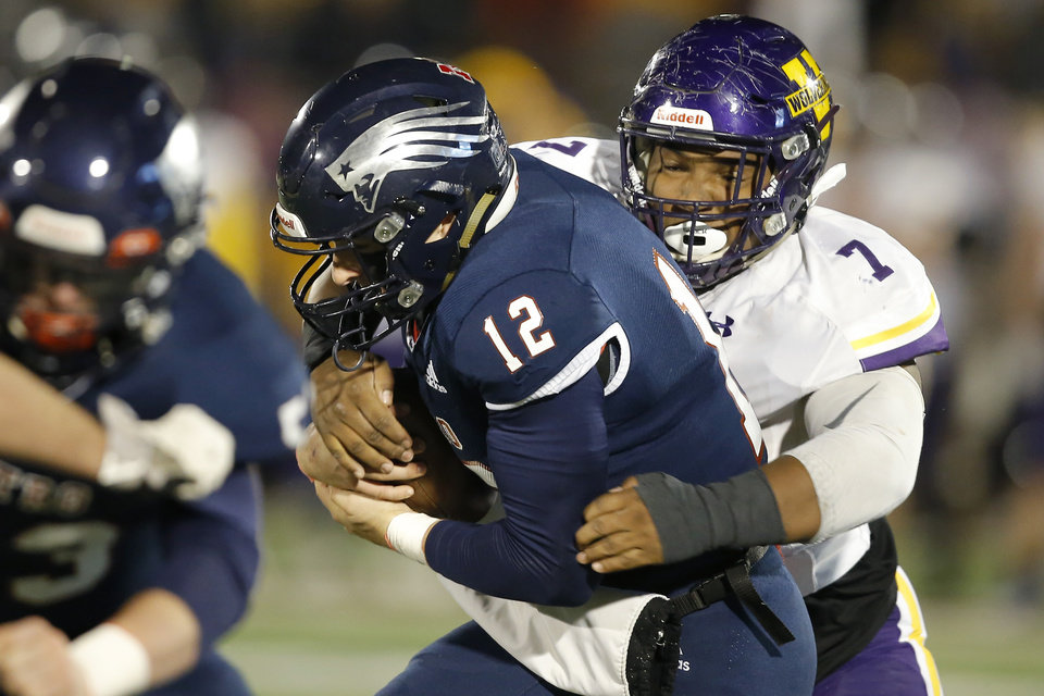Photo - Tulsa Metro Christian's Asher Link is brought down by Vian's Solomon Wright during the Class 2A football state championship game between Tulsa Metro Christian and Vian at Wantland Stadium in Edmond, Okla., Saturday, Dec. 14, 2019. [Bryan Terry/The Oklahoman]