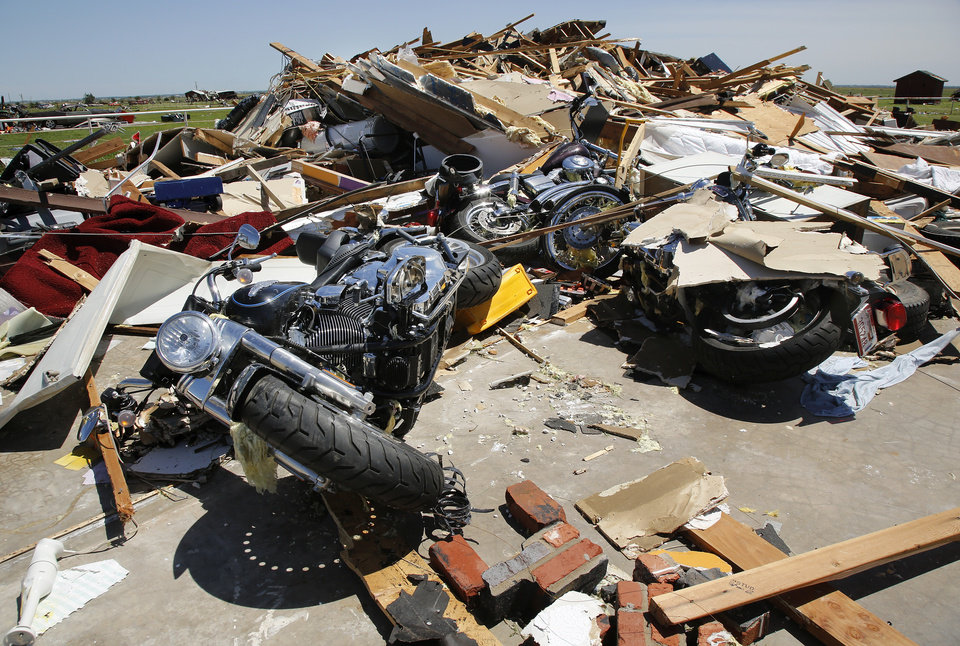 Photo - Three motorcycles were inside the garage of this house in Union City when it was destroyed in Friday nights tornado.  Photo  by Jim Beckel, The Oklahoman.
