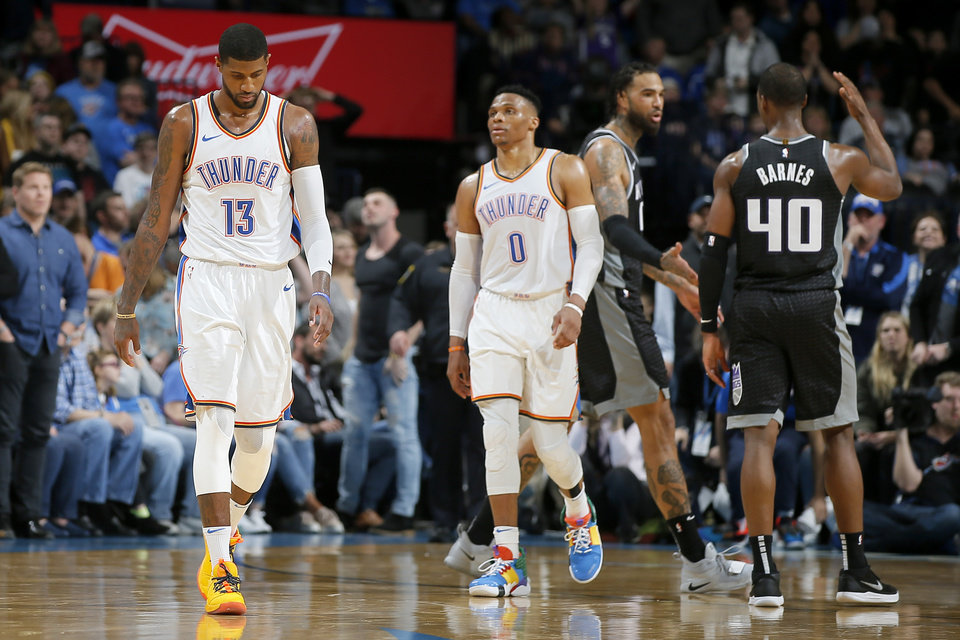 Photo - Oklahoma City's Paul George (13) and Russell Westbrook (0) walk off the court beside Sacramento's Harrison Barnes (40) and Willie Cauley-Stein (00) after an NBA basketball game between the Oklahoma City Thunder and the Sacramento Kings at Chesapeake Energy Arena in Oklahoma City, Saturday, Feb. 23, 2019. Sacramento won 119-116. Photo by Bryan Terry, The Oklahoman