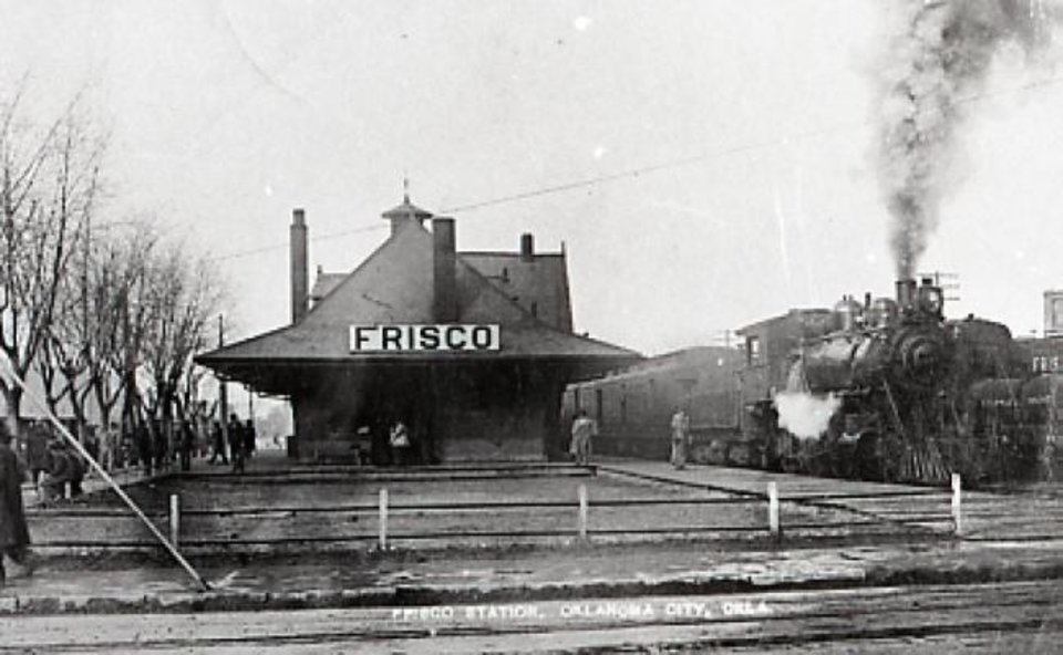 Photo -  A train is photographed leaving the Frisco station in 1914. [OKLAHOMA HISTORICAL SOCIETY]