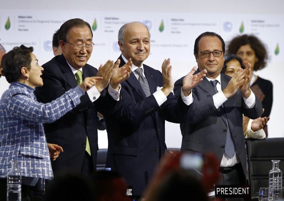 Photo -  FILE - In this Dec. 12, 2015 file photo, from left, United Nations climate chief Christiana Figueres, United Nations Secretary-General Ban Ki-moon, French Foreign Minister and president of the COP21 Laurent Fabius and French President Francois Hollande applaud after the final conference at the COP21, the U.N. conference on climate change, in Le Bourget, north of Paris. Five years after a historic climate deal in Paris, world leaders are again meeting to increase their efforts to fight global warming. (AP Photo/Francois Mori)