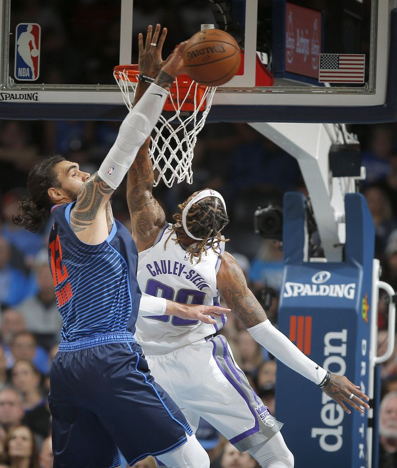 Photo - Oklahoma City's Steven Adams (12) blocks the shot of Sacramento's Willie Cauley-Stein (00) during an NBA basketball game between the Oklahoma City Thunder and the Sacramento Kings at Chesapeake Energy Arena in Oklahoma City, Sunday, Oct. 21, 2018. Photo by Bryan Terry, The Oklahoman