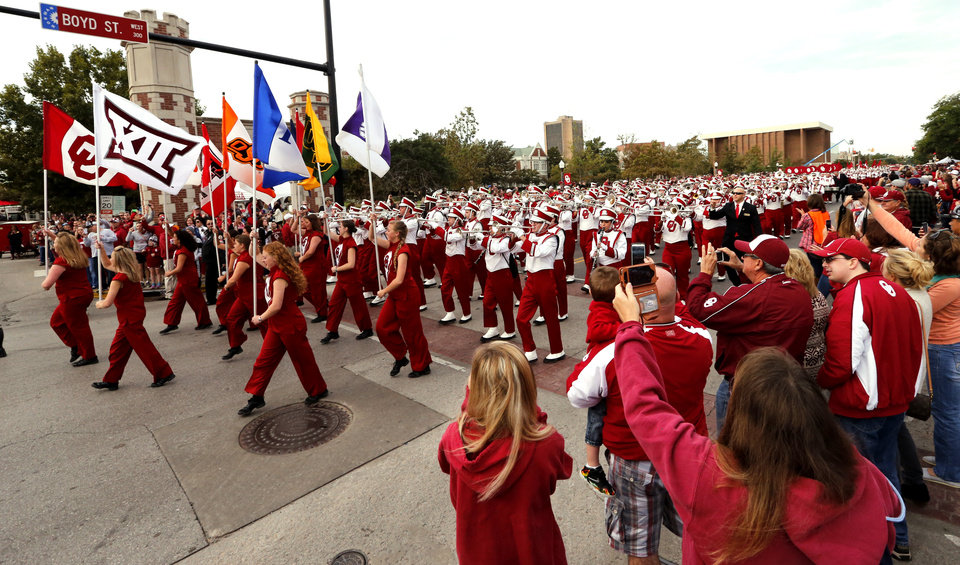 "Photo - University of Oklahoma ""Pride"" marching band, leads the procession during the Homecoming Parade before a college football game between the University of Oklahoma Sooners (OU) and the Kansas State Wildcats at Gaylord Family-Oklahoma Memorial Stadium in Norman, Okla., on Saturday, Oct. 18, 2014. Photo by Steve Sisney, The Oklahoman"