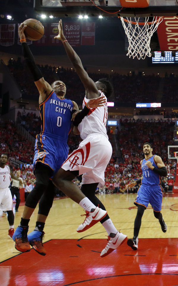 Photo - Oklahoma City's Russell Westbrook (0) goes to the basket as Houston's Clint Capela (15) defends during Game 2 in the first round of the NBA playoffs between the Oklahoma City Thunder and the Houston Rockets in Houston, Texas,  Wednesday, April 19, 2017.  Photo by Sarah Phipps, The Oklahoman