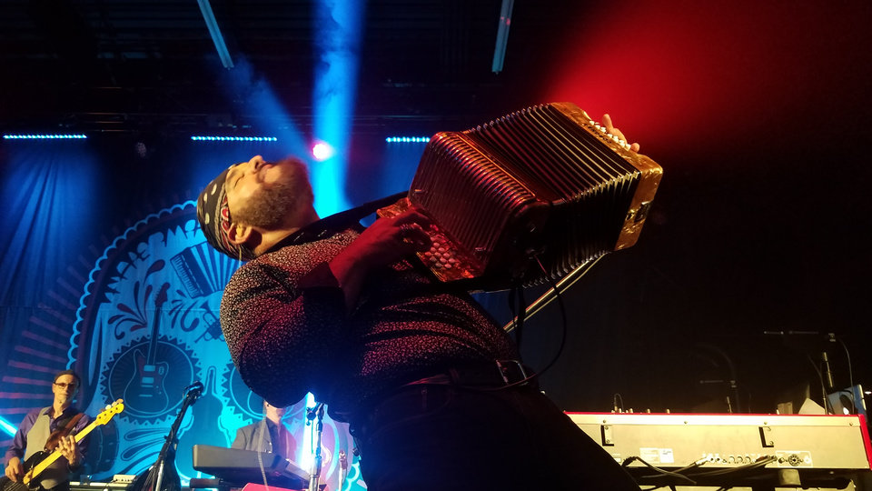 Photo -  The Mavericks accordion player Michael Guerra performs at Tower Theatre. [PHOTO BY ED GODFREY, THE OKLAHOMAN]