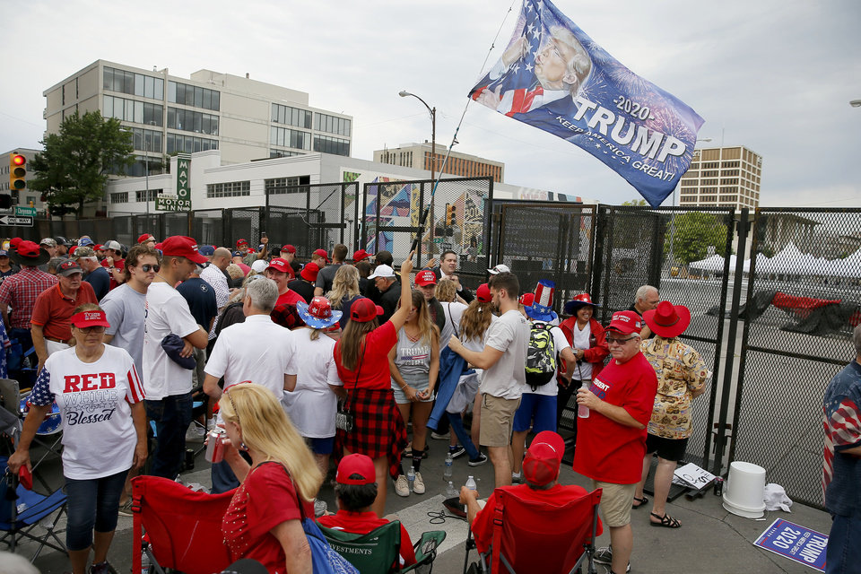 Photo - President Donald Trump supporters wait outside a security gate before a rally at the BOK Center in Tulsa, Okla., Saturday, June 20, 2020. [Bryan Terry/The Oklahoman]