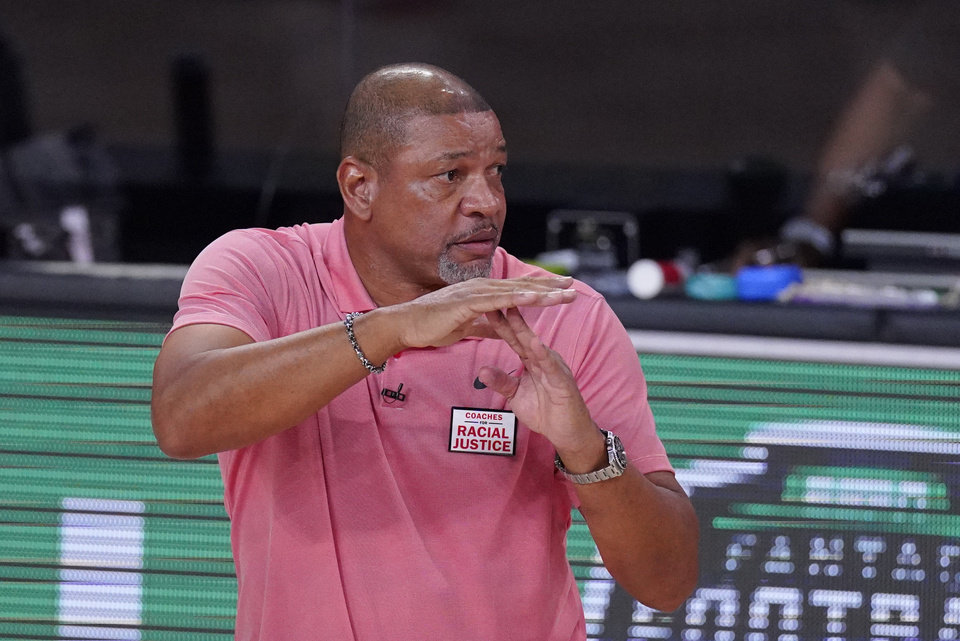 Photo - Los Angeles Clippers head coach Doc Rivers calls a timeout during the second half of an NBA conference semifinal playoff basketball game against the Denver Nuggets, Wednesday, Sept. 9, 2020, in Lake Buena Vista, Fla. (AP Photo/Mark J. Terrill)