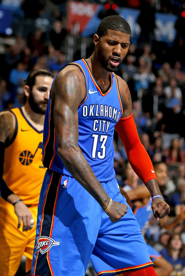Photo - Oklahoma City's Paul George (13) celebrates a basket during the NBA game between the Oklahoma City Thunder and the Utah Jazz at the Chesapeake Energy Arena, Friday, Feb. 22, 2019. Photo by Sarah Phipps, The Oklahoman
