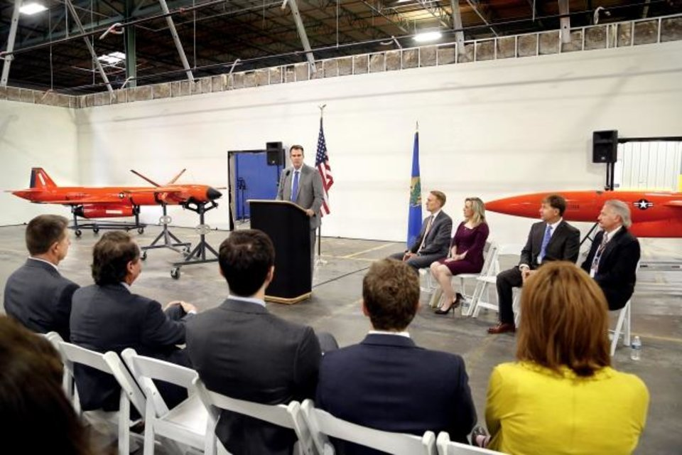 Photo -  Gov. Kevin Stitt speaks at  a reception Wednesday at the Kratos Defense manufacturing facility. [JIM BECKEL/THE OKLAHOMAN]