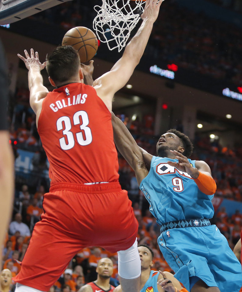 Photo - Oklahoma City's Jerami Grant (9) puts up a shot beside Portland's Zach Collins (33) during Game 3 in the first round of the NBA playoffs between the Portland Trail Blazers and the Oklahoma City Thunder at Chesapeake Energy Arena in Oklahoma City, Friday, April 19, 2019. Oklahoma City won 120-108. Photo by Bryan Terry, The Oklahoman