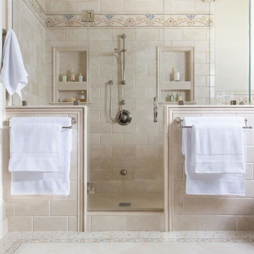 Photo -  To add a Zen feel to your bathroom, minimize or eliminate patterns and keep your color palette light. You can't go wrong with white towels. [CRANEANDCANOPY.COM]