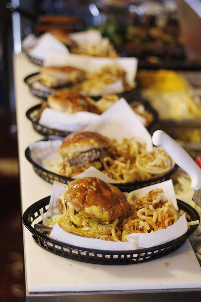 Photo - Burgers and fries at Nic's Grill, Friday, March 27, 2015. Photo by Doug Hoke, The Oklahoman