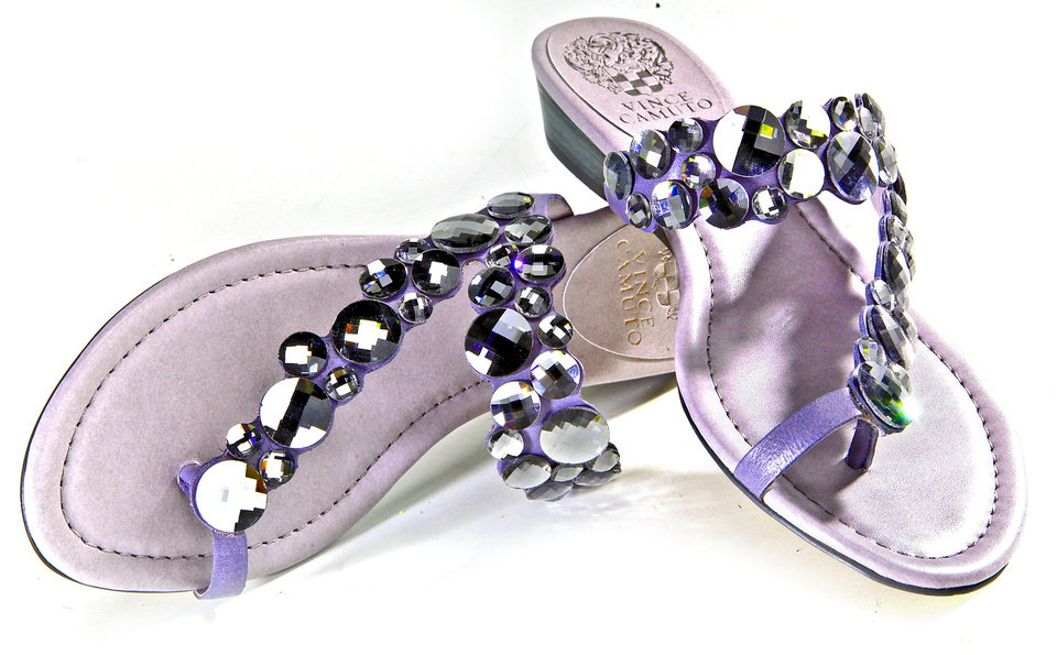 Photo - Silver jeweled flat sandals by Vince Camuto, sold at Funky Monkey. Chris Landsberger, The Oklahoman.  CHRIS LANDSBERGER