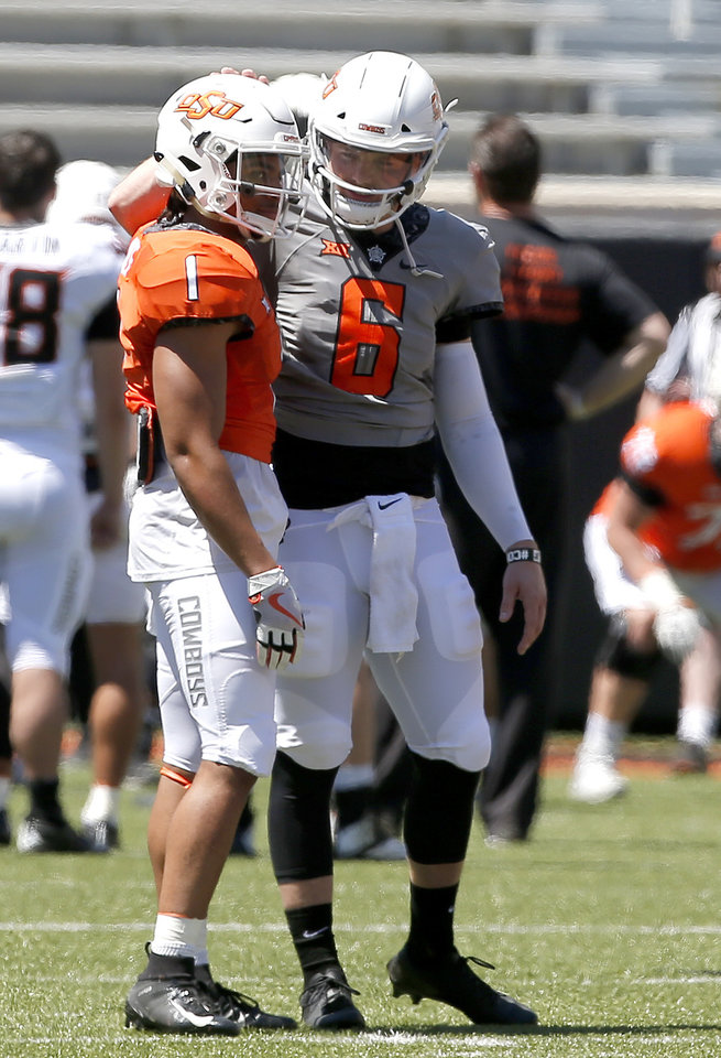 Photo - Oklahoma State's Dru Brown (6) talks with Oklahoma State's Landon Wolf (1) during drills during the Oklahoma State Cowboys spring practice at Boone Pickens Stadium in Stillwater, Okla., Saturday, April 20, 2019.  Photo by Sarah Phipps, The Oklahoman