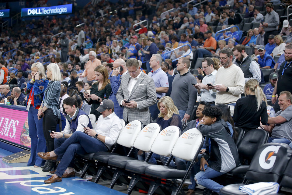 Photo - Oklahoma City Thunder fans wait for an announcement before an NBA basketball game between the Oklahoma City Thunder and the Utah Jazz was postponed at Chesapeake Energy Arena in Oklahoma City, Wednesday, March 11, 2020. [Bryan Terry/The Oklahoman]