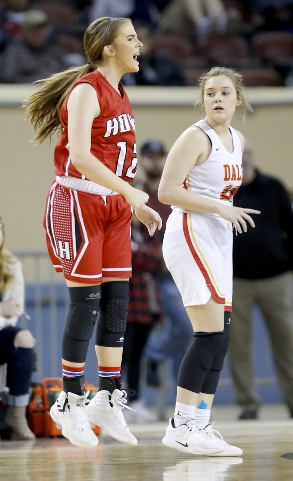 Photo - Howe's Caitlyn Stacy celebrates a 3-point basket in front of Dale's Lacey Savage during the 2A girls state high school basketball championship at Jim Norick State Fair Arena, the Big House, at State Fair Park in Oklahoma City,  Saturday, March 9, 2019. Photo by Sarah Phipps, The Oklahoman