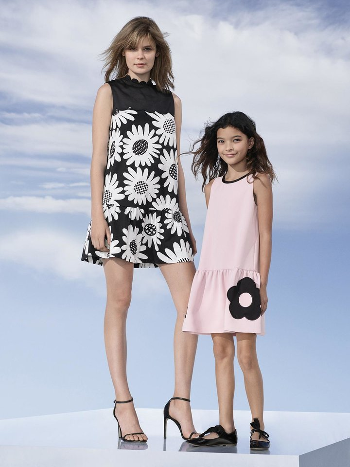 Photo - Daisy drop waist dress, $40, and girls' flower pocket dress, $28, by Victoria Beckham for Target. [Photo Provided]
