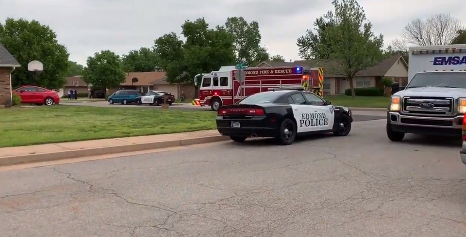 Photo -  Emergency officials respond to an Edmond residential area where a 17-year-old was shot and killed by officers Monday. [Twitter image/Edmond Police]
