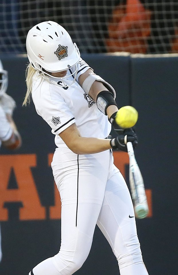 Photo - Oklahoma State's Samantha Show (3) drives a run in on a double in the second inning of the Stillwater Regional NCAA softball tournament game between Oklahoma State (OSU) and BYU in Stillwater, Okla., Thursday, May 16, 2019. Oklahoma State won 3-1. [Bryan Terry/The Oklahoman]