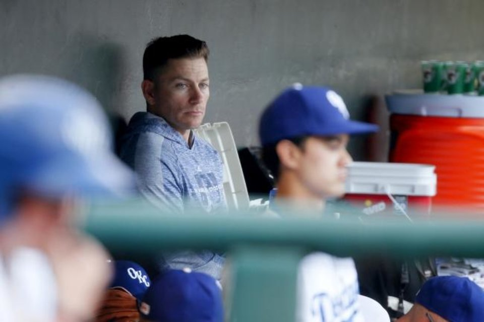 Photo -  Oklahoma City outfielder Blake Gailen watches from the dugout Wednesday after pitching effectively in relief Tuesday night for the Dodgers. [Bryan Terry, The Oklahoman]