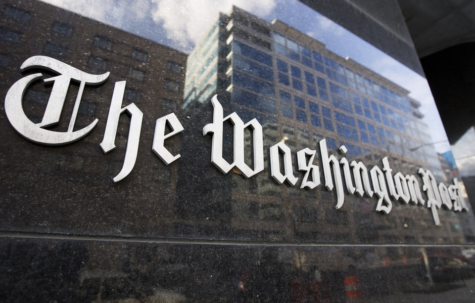 Photo - FILE -  In this Feb. 27, 2008, file photo, The Washington Post sign is seen on its building in Washington. On Monday, Aug. 5, 2013, the Washington Post announced the paper has been sold to Amazon founder Jeff Bezos. (AP Photo/Manuel Balce Ceneta, File) ORG XMIT: WX121