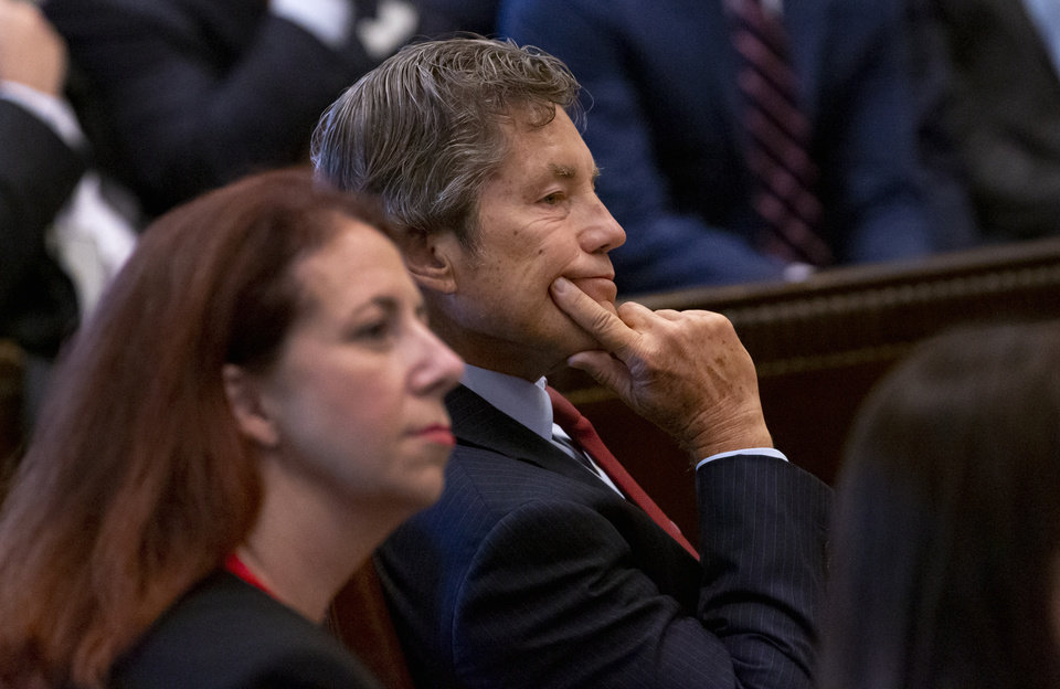 Photo - Defense attorney Larry Ottaway listens in as Judge Thad Balkman reads a summery of his decision in the opioid trial at the Cleveland County Courthouse in Norman, Okla. on Monday, Aug. 26, 2019. Judge Balkman ruled in favor of the State of Oklahoma, that Johnson and Johnson pay $572 million to a plan to abate the opioid crisis. The proceeding were the first public trial to emerge from roughly 2,000 U.S. lawsuits aimed at holding drug companies accountable for the nation's opioid crisis.  [Chris Landsberger/Pool]