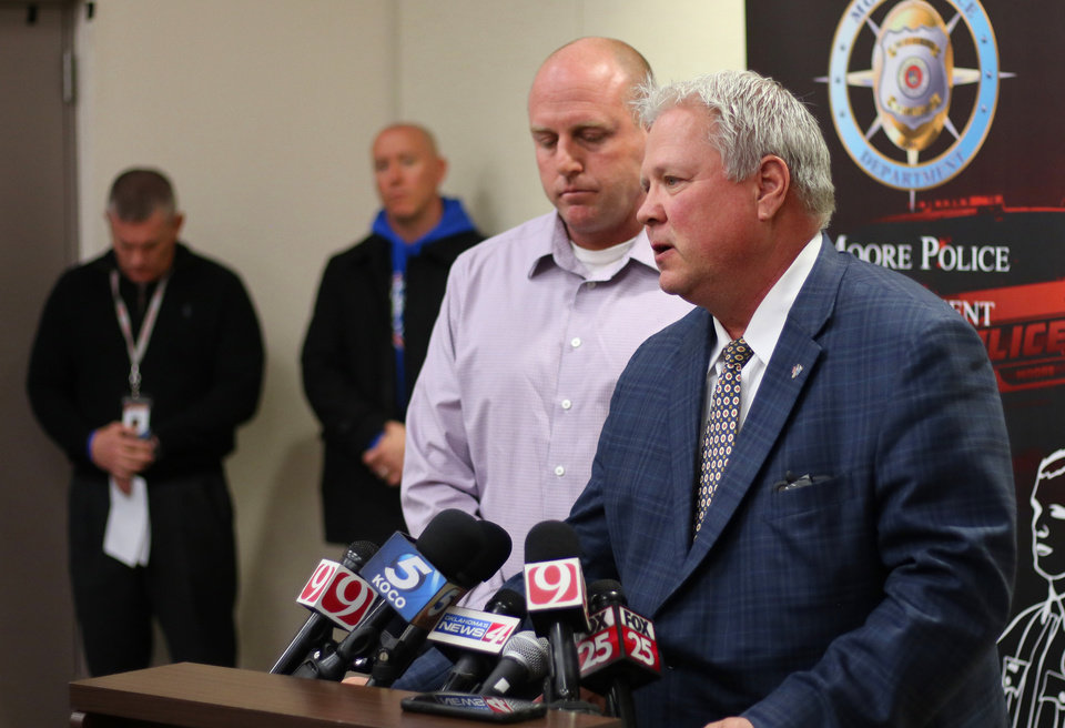 Photo -  Moore police Chief Todd Strickland and Sgt. Jeremy Lewis talk at a news conference Tuesday about the Moore High School students who were run over by a pickup the day before. [Photo by Doug Hoke/The Oklahoman]