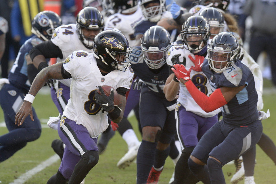 Photo -  Baltimore Ravens quarterback Lamar Jackson (8) scrambles against the Tennessee Titans in the second half of an NFL wild-card playoff football game Sunday, Jan. 10, 2021, in Nashville, Tenn. The Ravens won 20-13. (AP Photo/Mark Zaleski)