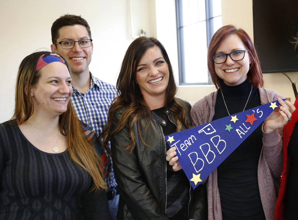 Photo -  Brandi Davis, center, faced years behind bars after she was arrested for allegedly shoplifting and possessing a syringe. An opioid addict, Davis has been in the ReMerge program for nearly a year and is now working at the Better Business Bureau. She is pictured with two ReMerge program graduates who work with her at the BBB, Brittany Takal, left, and Jessica Rider, right, and Ryan Ellis, vice president of business development. [Photo by Jim Beckel, The Oklahoman]