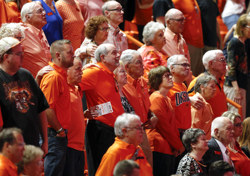 Photo - Oklahoma State fans sing the alma mater at the end of the Celebration of Life for OSU alumnus and benefactor Boone Pickens at Gallagher-Iba Arena in Stillwater, Okla., Wednesday, Sept. 25, 2019. [Nate Billings/The Oklahoman]