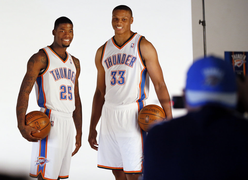 Photo - DeAndre Liggins, left, and Daniel Orton pose for a photo during media day for the Oklahoma City Thunder NBA basketball team at the Thunder Events Center in Oklahoma City, Monday, Oct. 1, 2012.  Photo by Nate Billings, The Oklahoman