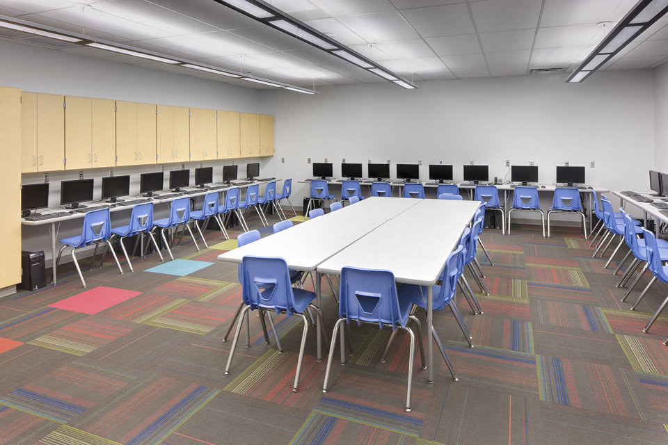 Photo - A computer lab at Holmes Park Elementary in Sapulpa doubles as a safe room. The school was designed by LWPB Architecture in Oklahoma City.  Lisa Chronister, an architect and principal at the firm, said a computer lab makes sense as a safe room because windows aren't needed and students are only in there occasionally, not all day.  Don Shreve - Provided/Shreve Photography