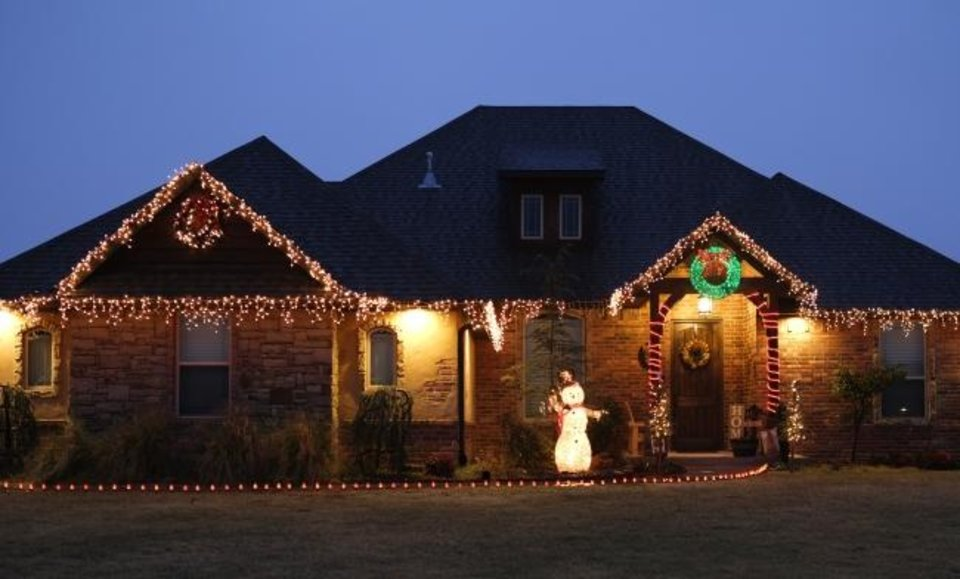 Photo -  Christmas decorations at 886 Fox Drive in Choctaw. [DOUG HOKE/THE OKLAHOMAN]