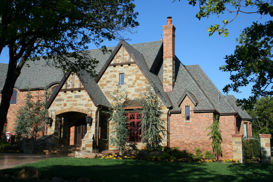 Trees Frame The Brick And Stone Chimney With A Pot Top On A Home