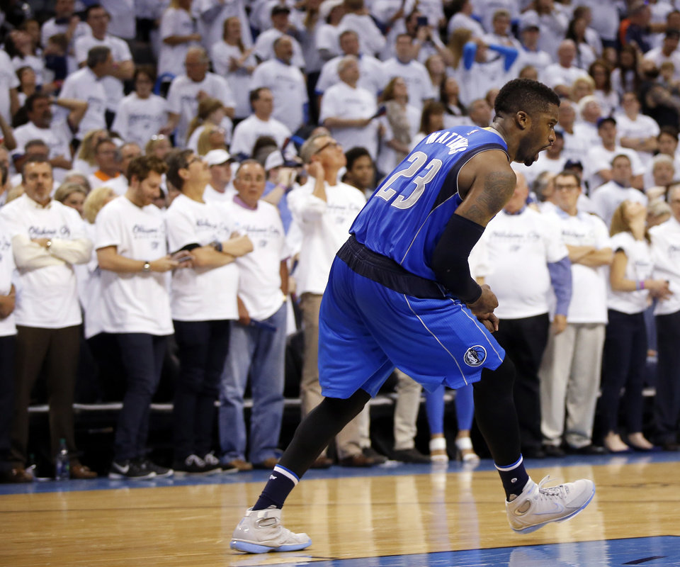 Photo - Dallas' Wesley Matthews (23) celebrates after scoring the last basket by the Mavericks in the fourth quarter during Game 2 of the first round series between the Oklahoma City Thunder and the Dallas Mavericks in the NBA playoffs at Chesapeake Energy Arena in Oklahoma City, Monday, April 18, 2016. Dallas won 85-84. Photo by Nate Billings, The Oklahoman