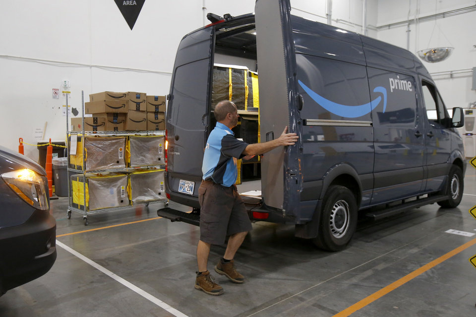 Photo - Anthony Miller with Crimson Transport gets ready to load his van inside the new Amazon Delivery Center in Oklahoma City, Tuesday, Oct. 23, 2018. Photo by Bryan Terry, The Oklahoman