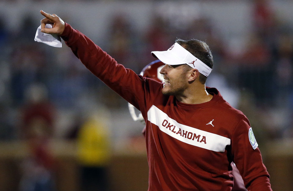 Photo - FILE - In this Saturday, Sept. 22, 2018, file photo, Oklahoma head coach Lincoln Riley gestures in the second of an NCAA college football game against Army in Norman, Okla. Oklahoma's hopes of making the college football playoff went washing down the Red River, after losing to Texas. (AP Photo/Sue Ogrocki, File)