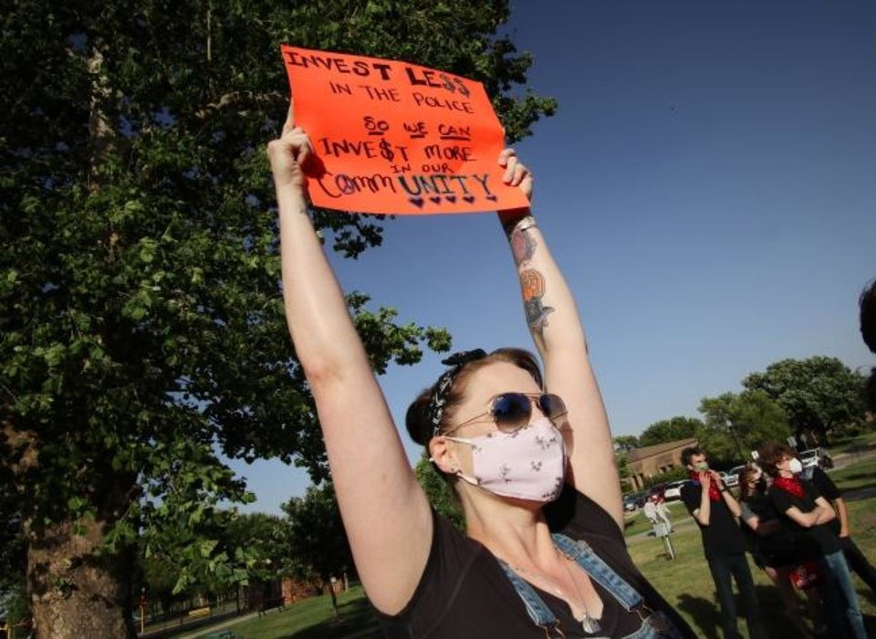 Photo -  Lauren Medford participates in a protest in Norman on Tuesday. [Doug Hoke/The Oklahoman]