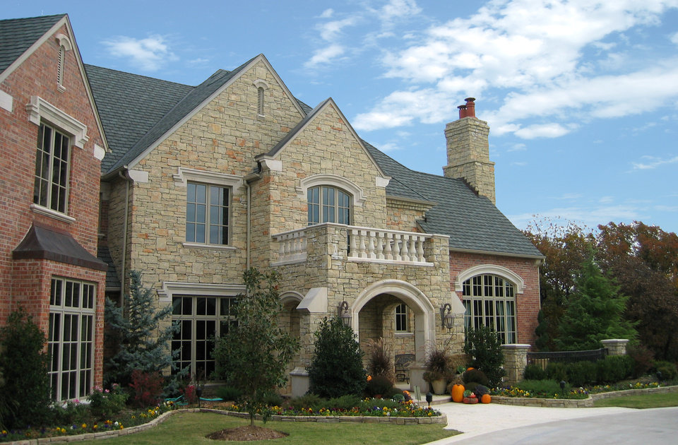 in this brick and stone design the chimney goes with the stone photo provided by brent gibson classic home design - Home Chimney Design