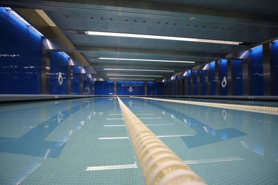 Photo -  The fitness center at Chesapeake Energy includes a swimming pool. [Doug Hoke/The Oklahoman]