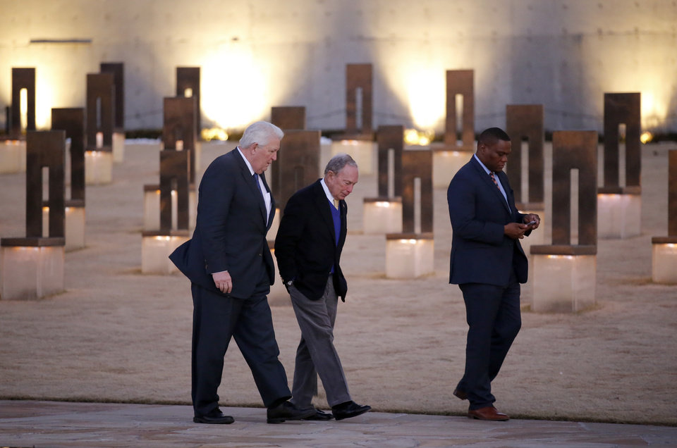 Photo - Democratic presidential candidate and former New York City Mayor Michael Bloomberg walks with Mike Turpen and Oklahoma state Rep. Monroe Nichols, 2020 Oklahoma Senior Advisor for the Bloomberg campaign, at the Oklahoma City National Memorial and Museum on Saturday, Feb. 8, 2020..  [Sarah Phipps/The Oklahoman]